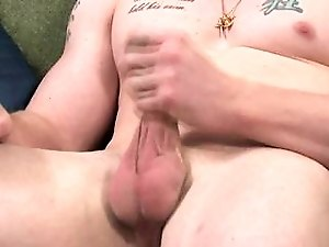Tattooed stud gets naked and shows off his hard cock