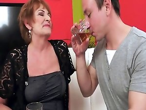 Redhead granny riding and sucking young cock